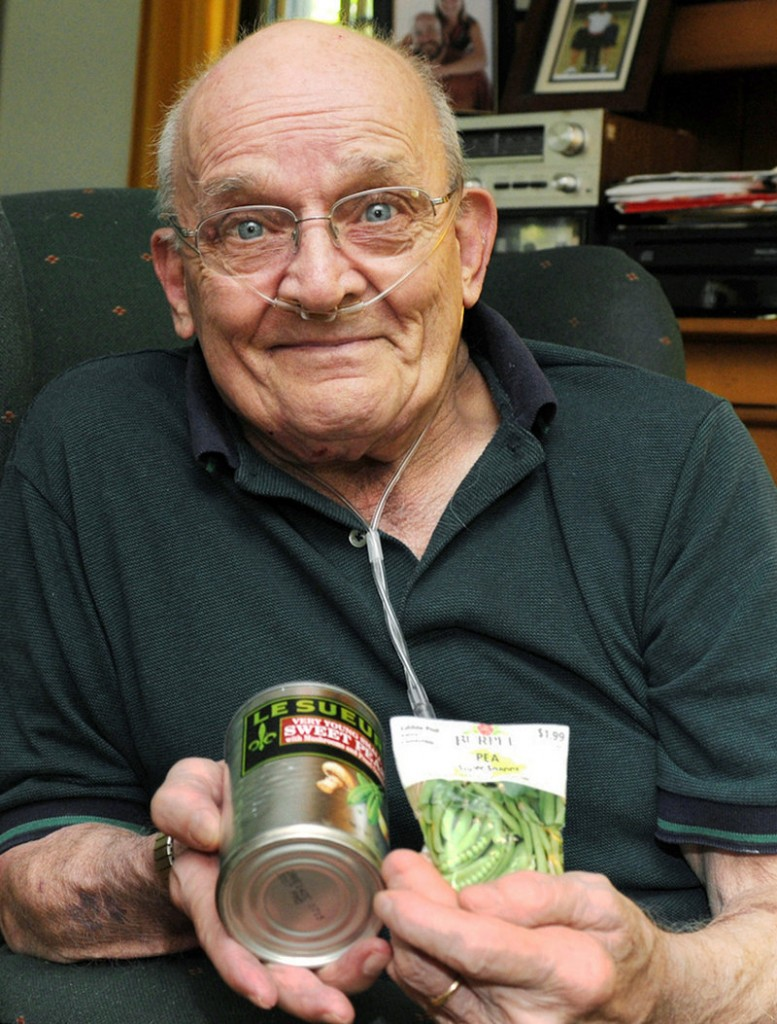 Ron Sveden, at home in Brewster, Mass., holds a can of peas and bag of pea seeds he received from friends after doctors discovered a pea growing in his lung.