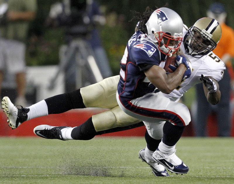 Patriots running back BenJarvus Green-Ellis protects the ball as he's brought down by Saints linebacker Jonathan Vilma. Green-Ellis had a touchdown run in New England's 27-24 exhibition win Thursday night.