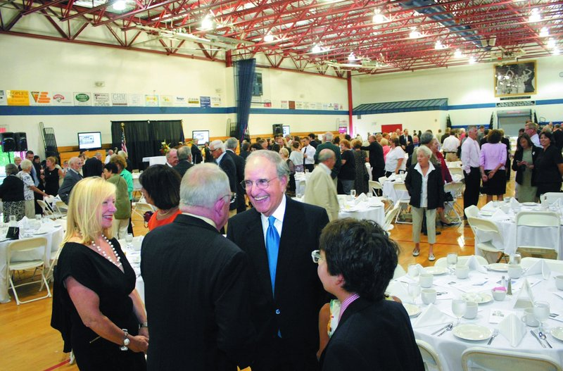 Former Sen. George Mitchell chats with renowned attorney F. Lee Bailey during the tribute to Mitchell at the Alfond Youth Center in Waterville on Thursday. Looking on is Bailey's companion, Debbie Elliott, and Mitchell's son Andrew, right.