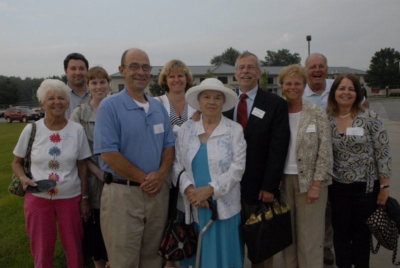 Georgette Nelson, center, with her family, from left, Janet Huot; Patrick and Jessica Ellison; Peter, Jane, Jim and Kathy Nelson; and Ernie and Dianna Huot at the 2009 dedication of the James E. Nelson Hall at Thornton Academy in Saco.