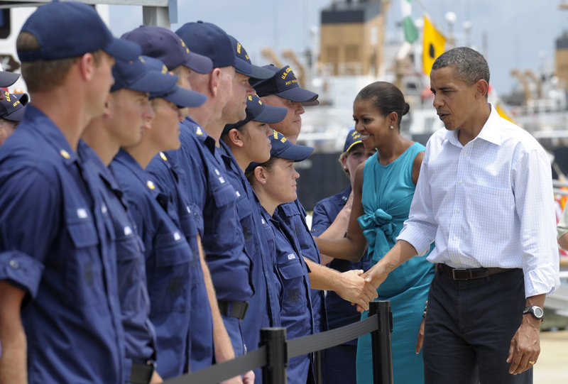 President Obama and first lady Michelle Obama greet members of the Coast Guard on Saturday while visiting the Guard's district office in Panama City, Fla.