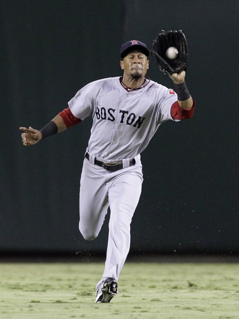 Red Sox center fielder Eric Patterson runs down a fly ball hit by Michael Young of the Rangers during Boston's 3-1 win Saturday night.