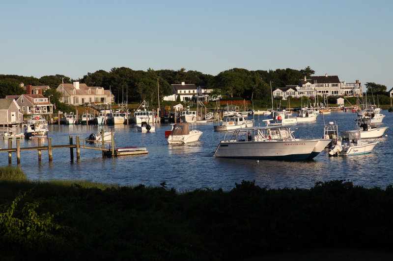 Privately owned boats are moored in Wychmere Harbor in Harwich, Mass. Groundfishing has virtually disappeared in this small port, and new fishing rules enacted in May have fishermen at New England's major ports worried their historic fishing communities could fade away as well.