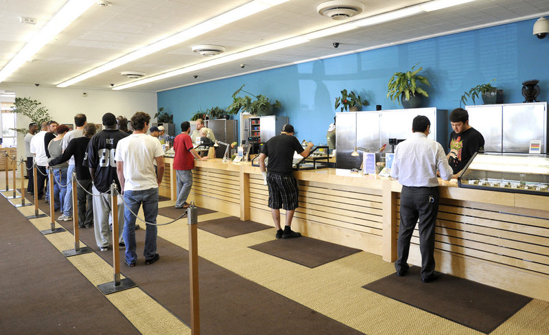 Patients wait in line for their medication at the Harborside Health Center in Oakland, Calif. Harborside serves up to 800 patients each day, did about $20 million in sales last year and employs 80 people with a starting wage of $14 per hour.