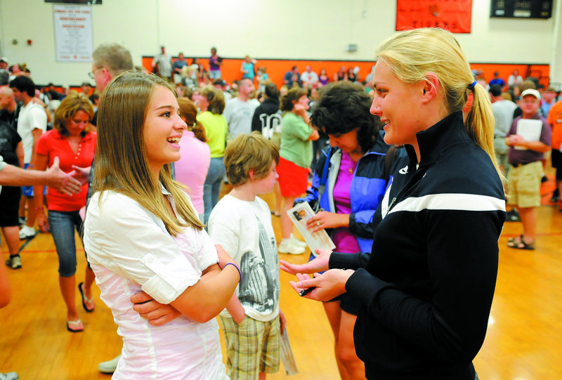 Olympian and Augusta resident Julia Clukey, right, talks with sophomore Tinsley DeForest Sunday at Gardiner Area High School.