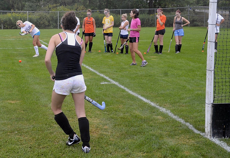Biddeford field hockey players execute a drill as they begin preparations for their season opener Sept. 2 at Kennebunk.