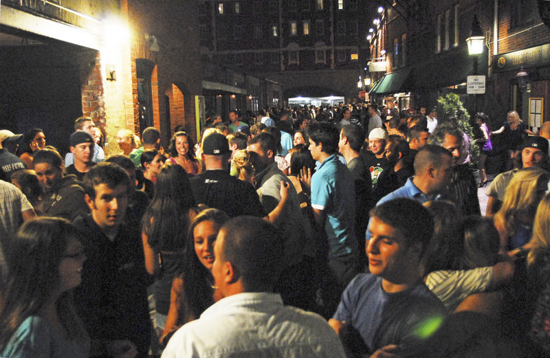 Though the night of Friday, Aug. 13, was uncommonly quiet in Portland's Old Port, closing time still resulted in a flood of young people on Wharf Street. This was the scene at about 1:15 a.m., a half-hour after last call.