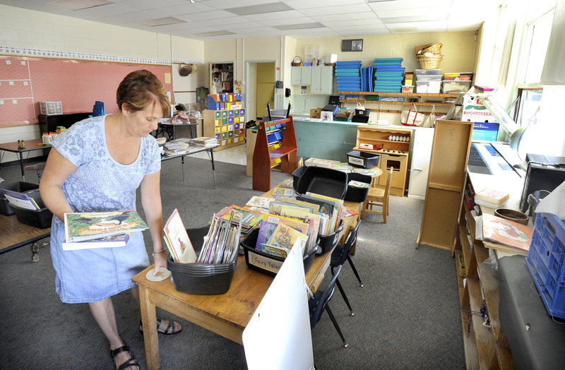 Suzanne Keller, a kindergarten teacher at Portland's Presumpscot Elementary School, sorts books as she prepares her classroom for the first day of school on Sept. 9.