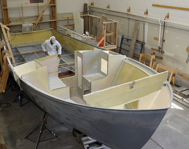 Steve Osborne, a technician at the Six Rivers Marine facility in North Yarmouth, takes measurements for installing gas tanks on a Blackhorse 29 being built at the boatyard, which was open to the public Tuesday as part of a two-day, first-of-its-kind event.