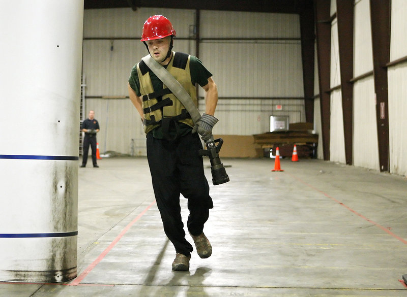 Robert Newberry, 31, a call firefighter in Raymond who aspires to become a full-time firefighter, participates in the Candidate Physical Ability Test at a warehouse on Read Street in Portland on Wednesday.
