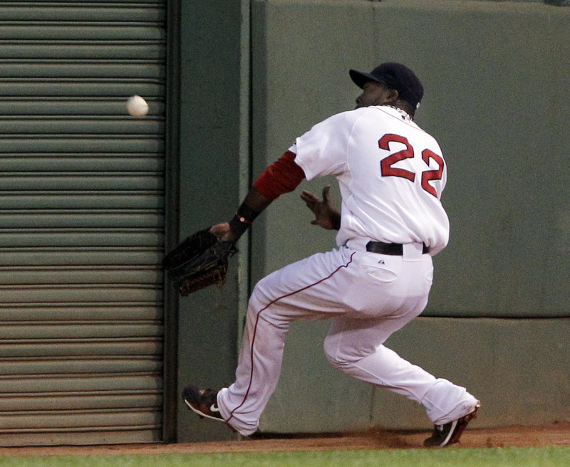 Red Sox left fielder Bill Hall pulls up near the wall and loses the fly ball hit by Maicier Izturis of the Angels in the second inning. Izturis ended up with a double. Hall homered in Boston's 7-5 victory Wednesday night at Fenway Park.
