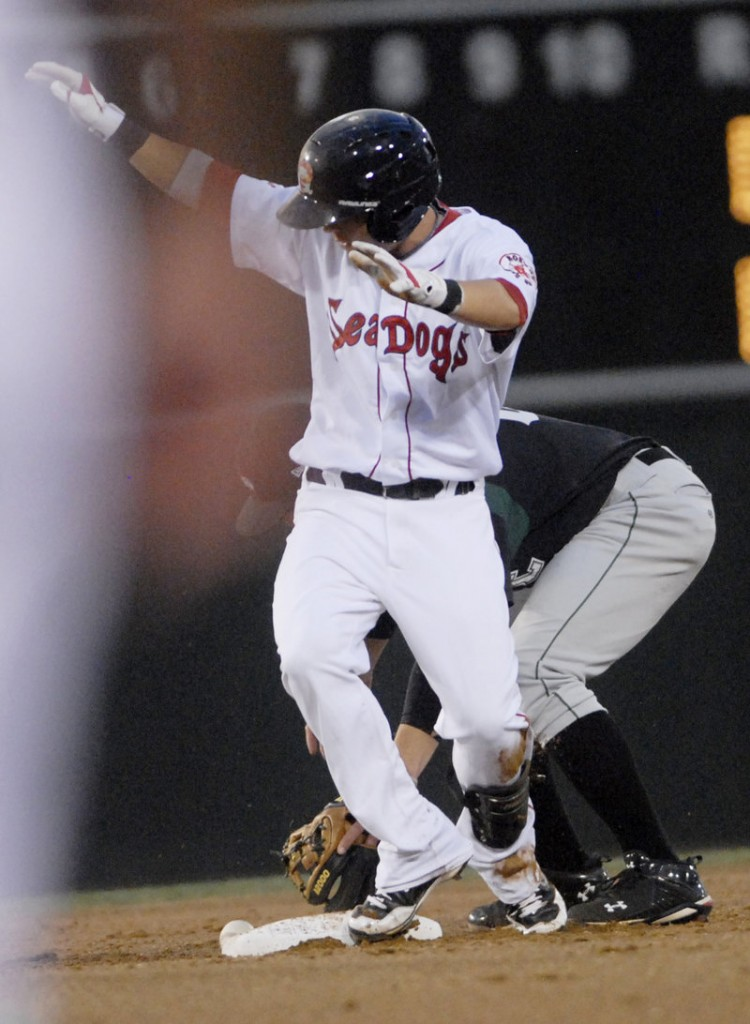Ryan Khoury of the Portland Sea Dogs beats the tag to reach second base with a double Wednesday night against the Altoona Curve at Hadlock Field. The Sea Dogs have lost the first two games of the three-game series against Altoona.