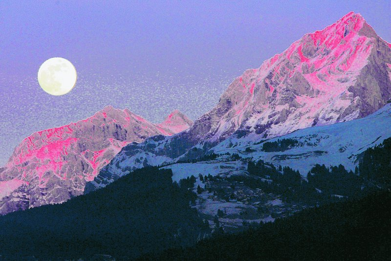 The moon rises above the Swiss alps: Several landforms around the moon suggest that the surface has shrunk as the interior has cooled over time and also shrunk.