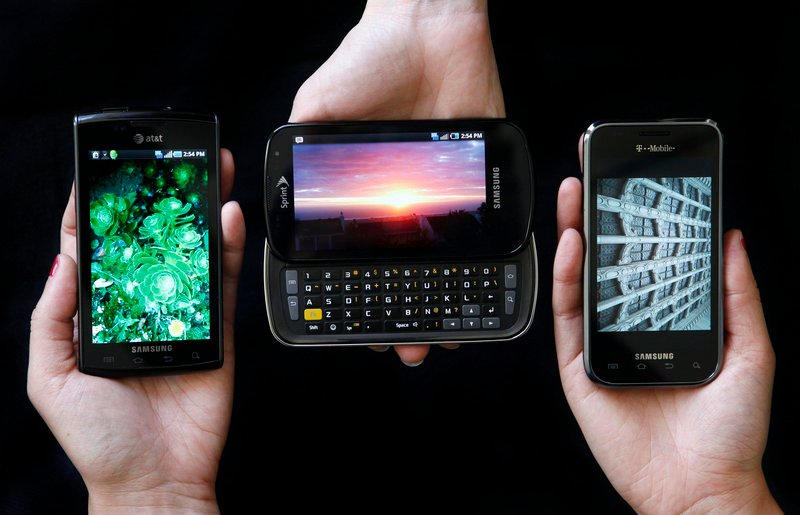 The Samsung Captivate, left, Samsung Epic 4G, center, and the Samsung Vibrant phones have some good features in common.