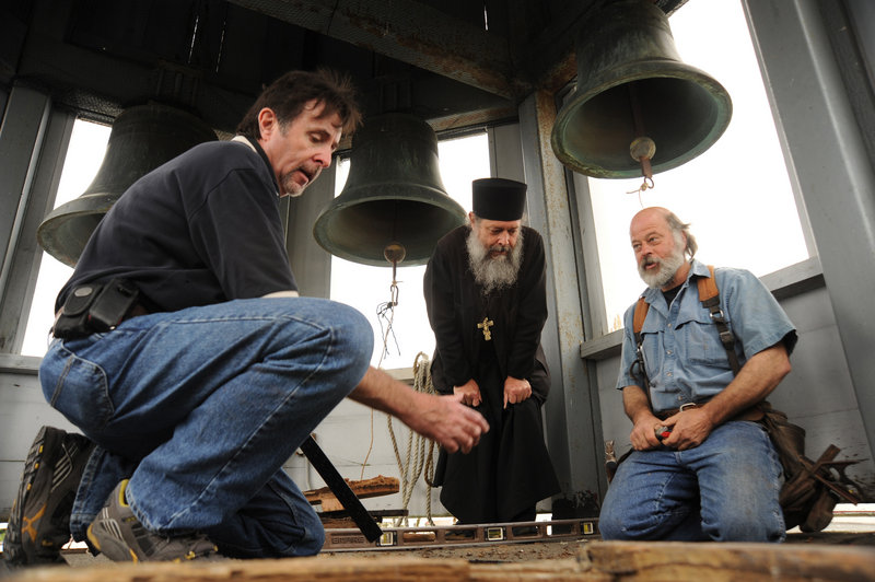Bob Medinger, director of the Sitka Historical Society, left, Father Sergious Gerken and contractor Pete Jones talk about improvements to the bell tower of St. Michael's Orthodox Cathedral in Sitka, Alaska. Traditional Russian Orthodox bell-ringing hasn't been heard at the cathedral for more than 40 years.