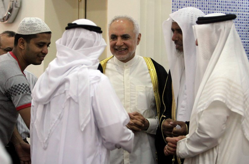 Imam Feisal Abdul Rauf, right, greets worshippers inside a mosque in Muharraq, Bahrain, after leading prayers Friday. Rauf, the imam leading plans for an Islamic center near ground zero in New York, is in the Mideast on a State Department outreach mission.