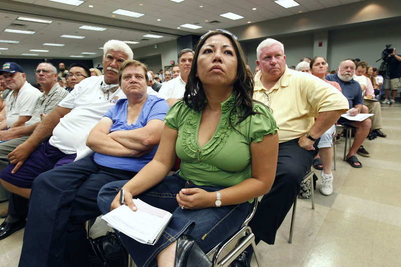 Residents listen to lawyer Kenneth Feinberg and Sen. Mary Landrieu, D-La., at a town hall meeting Wednesday in Kenner, La., for those economically affected by the BP oil spill. Many business owners fear that geographic guidelines will leave out deserving claimants.