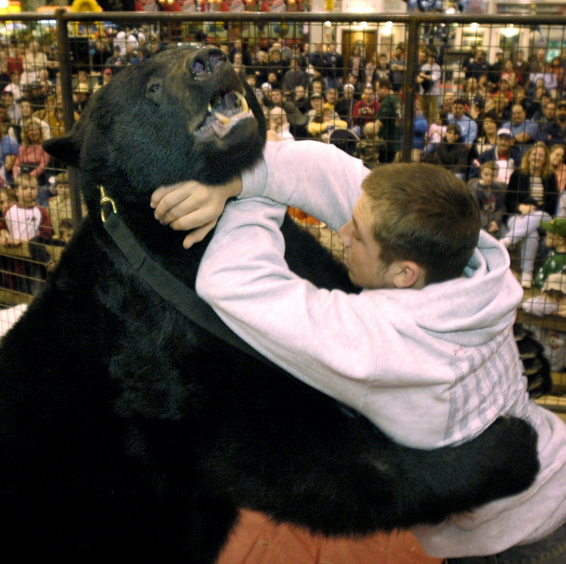 At a 2006 sportsmen's show in Cleveland, Lance Palmer takes on Ceaser, a black bear owned by Sam Mazzola. On Thursday, another bear owned by Mazzola fatally mauled its caretaker.