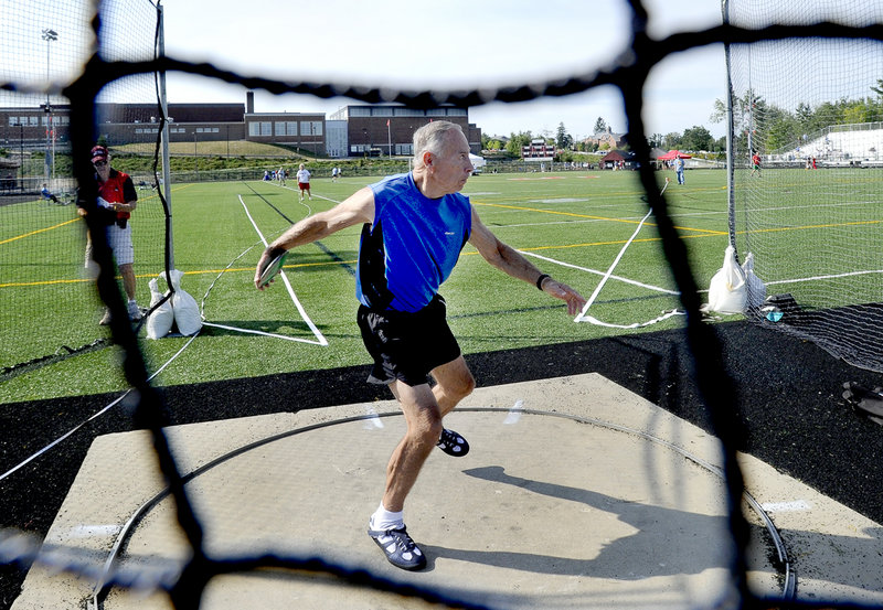 Henry DeForest, 75, of Hopkinton, Mass., unleashes the discus for a heave of 80 feet, 7 inches to finish second in his age group behind Joseph Hayes of Ocala, Fla.