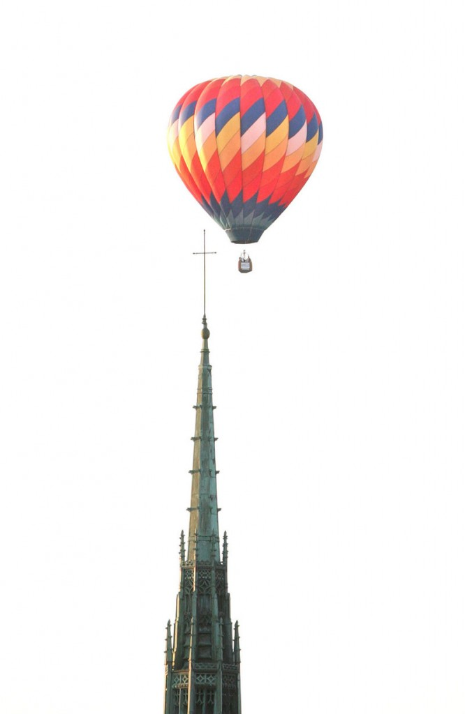 A balloon glides over the steeple of the Franco-American Heritage Center in Lewiston during the 6 a.m. launch at the Great Falls Balloon Festival on Saturday.