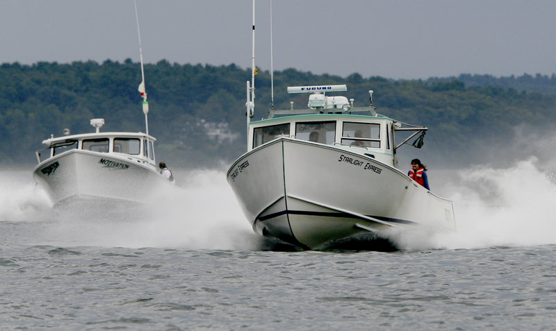 Motivation, left, and Starlight Express, right, head down the course during the Portland Lobster Boat Races.
