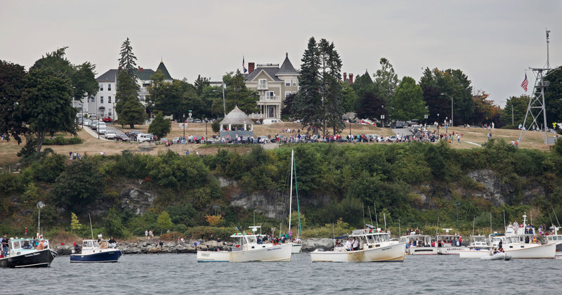 Spectators along the East End watch the Portland Lobster Boat Races on Sunday. More than 50 lobster boats participated in the first lobster boat race in Portland Harbor in 24 years.