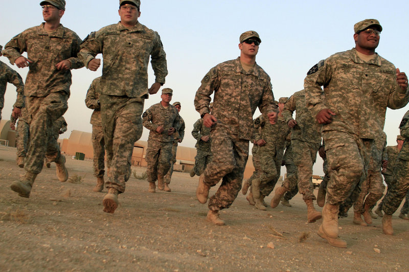 U.S. Army soldiers from 4th Battalion, 9th Infantry Regiment are dismissed from the casing ceremony for 4th Brigade, 2nd Infantry Division, the last American combat brigade to serve in Iraq, on Saturday at Camp Virginia, Kuwait.