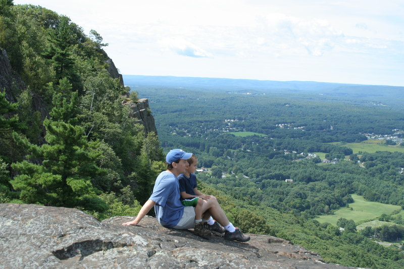 "The view from the top of a New England hike is a beautiful thing, and Maine author Jeff Romano, pictured with his son, has compiled a list of the best trails in his new book, ""100 Classic Hikes of New England."""