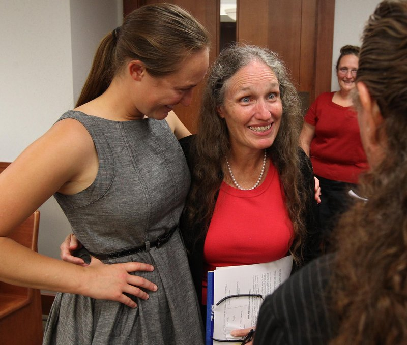 Shirley Phelps-Roper, right, hugs her niece Jael Phelps after an agreement was reached with Nebraska officials Monday in Papillion, Neb. Phelps-Roper agreed to drop federal lawsuits against Nebraska authorities in exchange for a prosecutor dismissing charges against her connected to a 2007 protest.