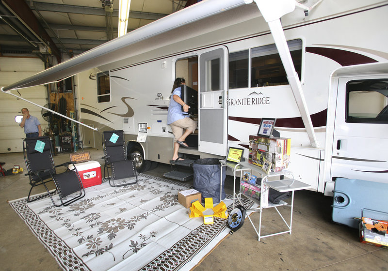 The Joneses viewed the inside of the new, fully furnished motor home they won Tuesday.