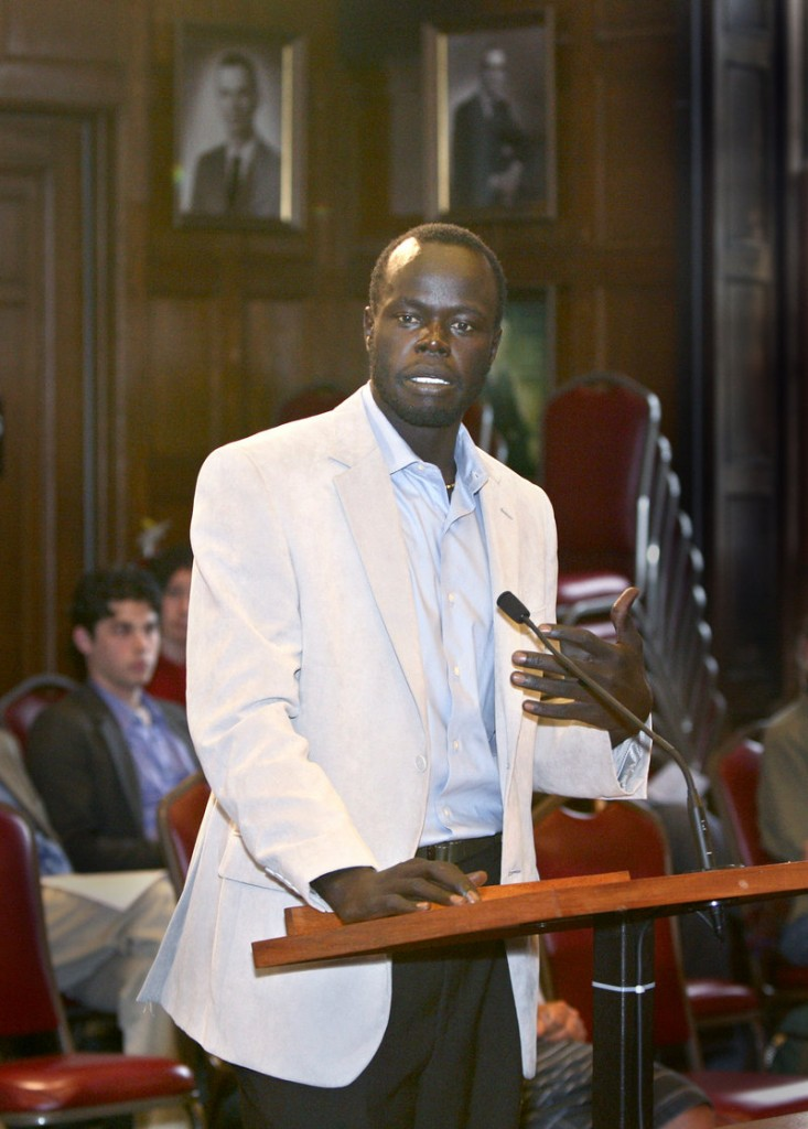 Alfred Jacob, a Sudanese immigrant and one of the leaders of the petition drive, speaks in favor of allowing non-citizens the right to vote during a public hearing Monday.