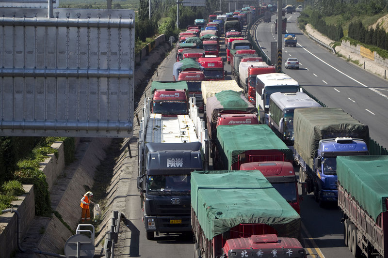 A section of the Beijing-Tibet highway in Huailai, in north China's Hebei province remains clogged with traffic on Tuesday. The massive traffic jam stems from road construction on one of three southbound highways feeding into Beijing that won't be finished until the middle of next month.