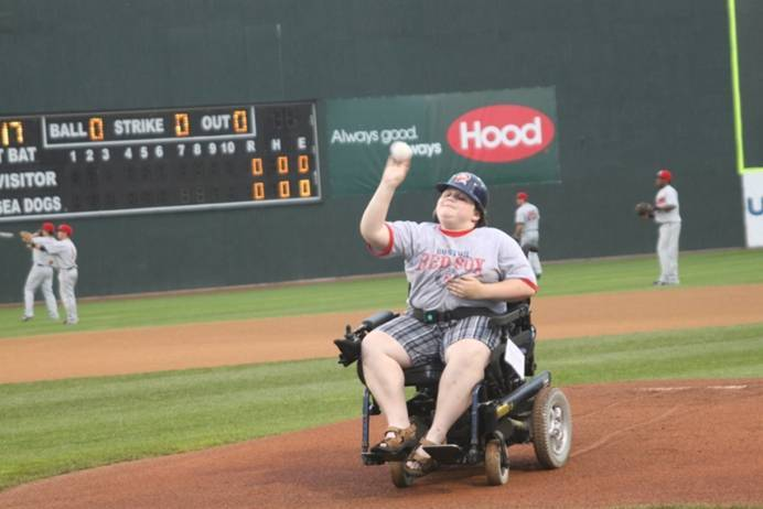 Zach Quinn, 12, Albion MDA Goodwill Ambassador, threw out the first pitch at the C.N.Brown sponsored Jerseys Off Their Backs event.