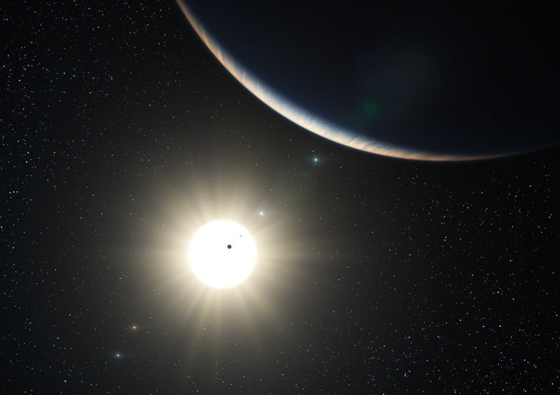 An artist's impression shows the planetary system around the sun-like star HD 10180. Observers at La Silla, Chile, found one planet with a mass about 1.4 times that of Earth.