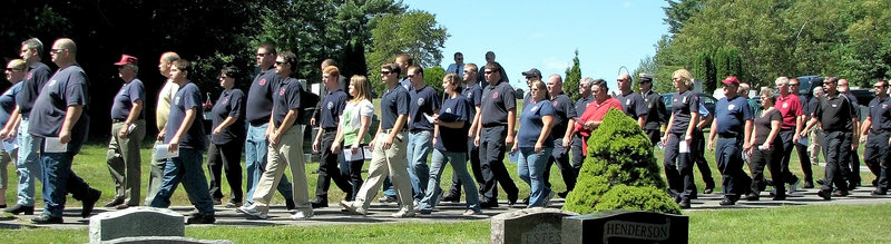 Fire and rescue workers from eight towns in Somerset County walked past the grave of Donna Lightbody, 63, on Tuesday to pay their respects. Lightbody was president of the Madison Fire Department Auxiliary and the wife of the town's fire chief.