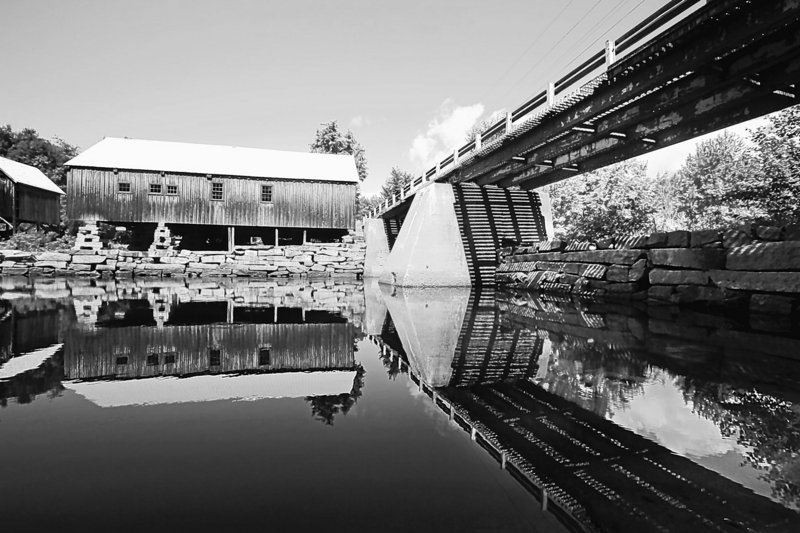 Reviving a historic hydro-powered saw mill on the Crooked River won't impede fish as badly as state officials say, according to the mill's backers.