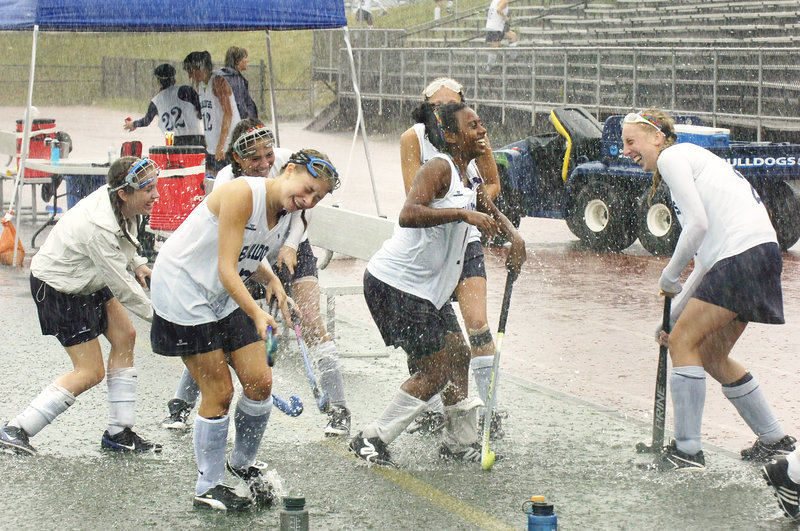 Seventeen teams were to play in the field hockey Play Day Wednesday at Fitzpatrick Stadium. So wouldn't you know, in a summer of glorious weather, Mother Nature picked Wednesday to get even. Didn't bother the Portland girls, though. Just have fun. And they did.