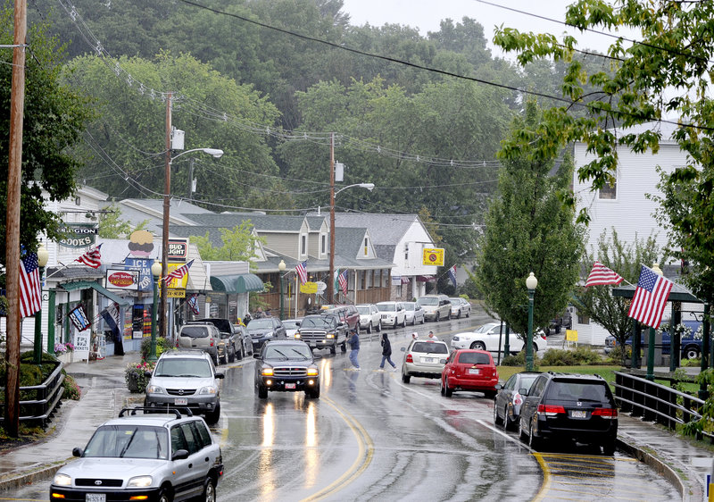 Traffic moves along Route 302 in Bridgton on Wednesday. The town is the latest example of a Maine community worrying about big chains in its midst.