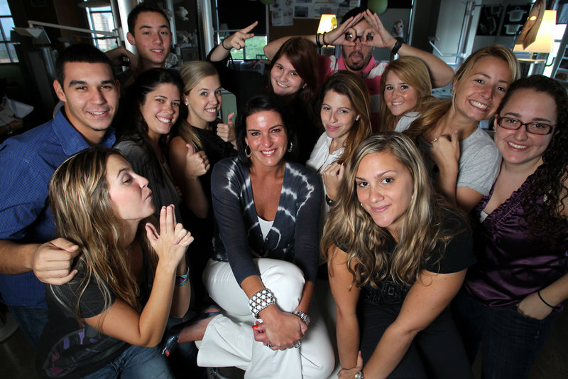 Michelle Zubizaretta, center, poses with some of her Gen-Y employees at her Zubi Adverstising in Coral Gables, Fla.