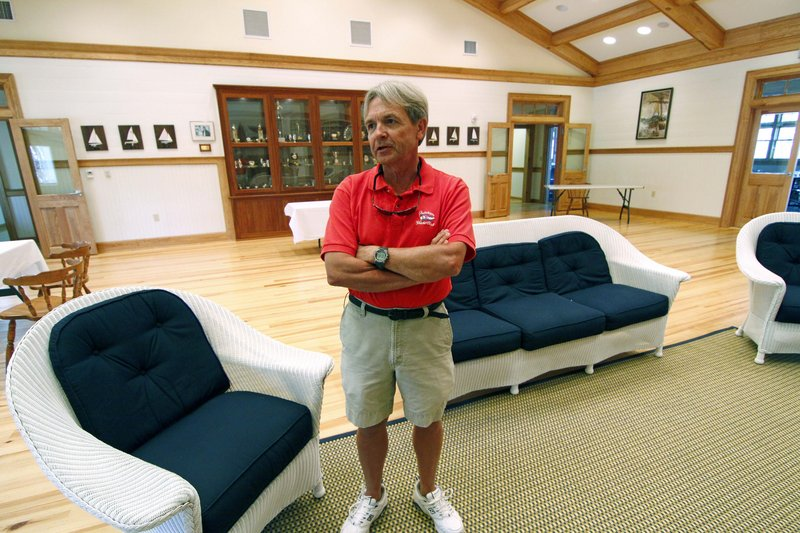 Erik Schmitz, former commodore of the Fairhope Yacht Club, says members helped navigate the system to obtain a loan of about $1.5 million to rebuild and expand the club's meeting hall in Fairhope, Ala. Other funds also were used.