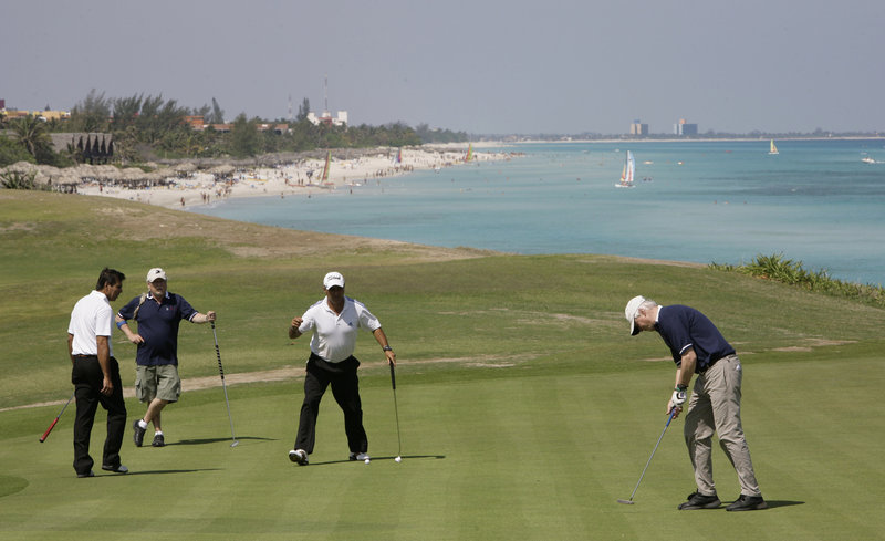 Golfers use a practice area during the Montecristo Cup Golf Tournament in Varadero, Cuba. Cuba has announced that it will allow foreign investors to lease government land for up to 99 years, potentially touching off a golf-course building boom.