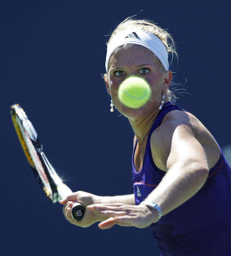 Melanie Oudin keeps her eyes on the ball during a first-round match against Olga Savchuk on Monday. Oudin won 6-3, 6-0 to advance to the second round.