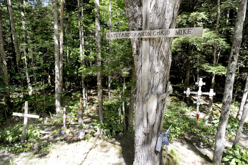 Memorials to car accident victims stand along a section of Route 11 in Casco where nine people have died in accidents in the last 10 years. Across the road from the memorials, a car driven by Nicholas Sparrow struck a tree early Sunday, killing two of his passengers.