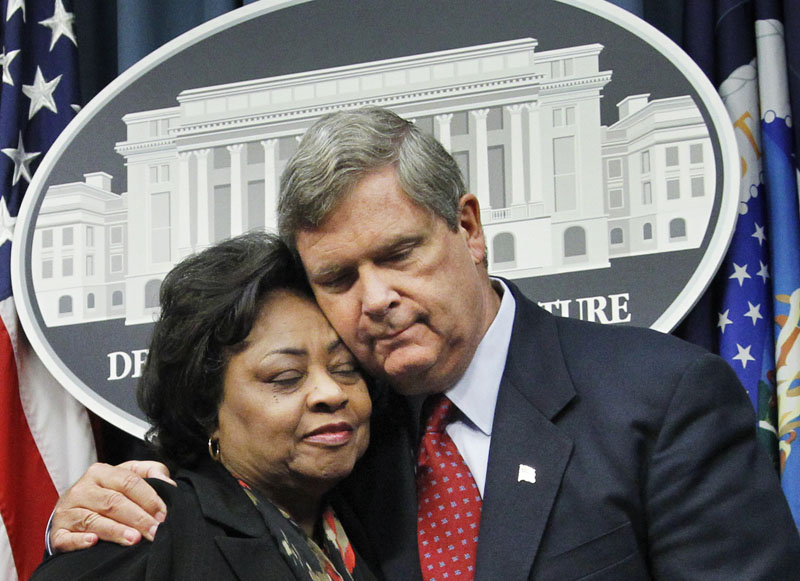 Department of Agriculture Secretary Tom Vilsack puts his arm around former Agriculture Department official Shirley Sherrod as they conclude a news conference in Washington today.