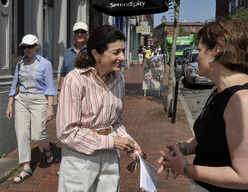 Maine's senior senator, Olympia Snowe, on a break from Senate proceedings, interacts with constituents in Portland's Old Port early last month.