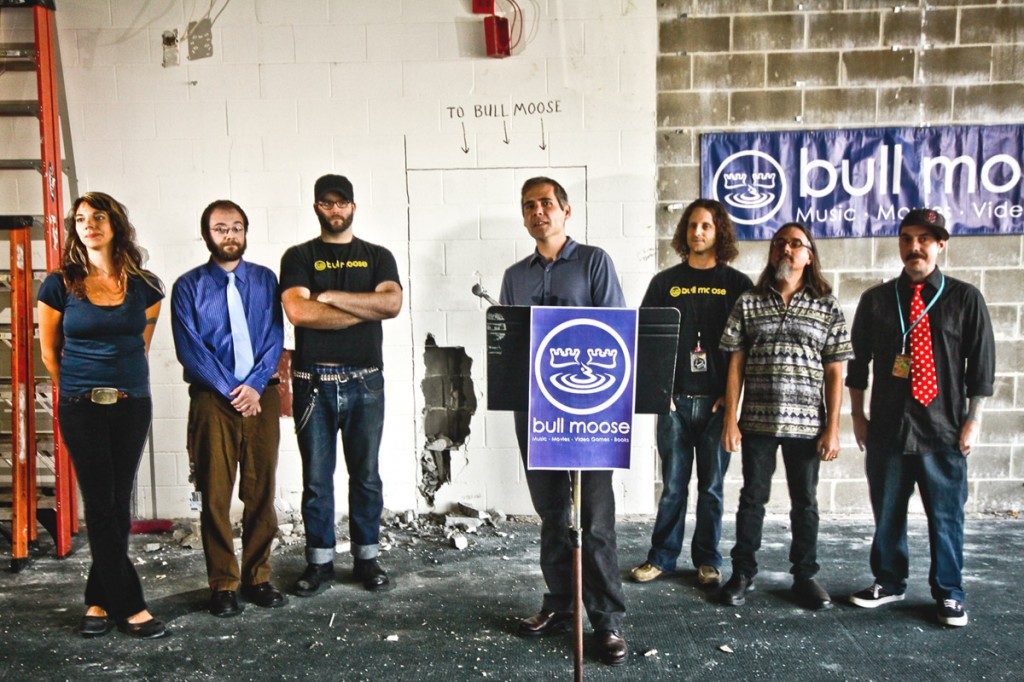Bull Moose Music owner Brett Wickard, center, announced the expansion of the Scarborough warehouse with location staff, pictured from left, Amber Dorcus, Chris Gilman, Matt Cargile, BJ Carr, Chris Brown and Jay Kelley.