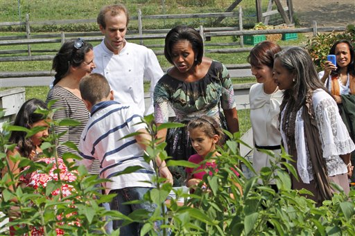 First lady Michelle Obama, Colombian first lady Maria Clemencia Rodriguez De Santos, second from right, and Haitian first lady Elisabeth D. Preval, take a tour of an herb garden at the Stone Barns Center with Executive Chef Dan Barber and local schoolchildren.