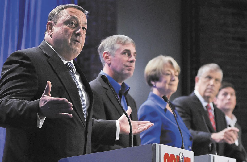 Republican Paul LePage, left, speaks as fellow gubernatorial candidates, from left to right, independent Shawn Moody, Democrat Libby Mitchell, independent Eliot Cutler and independent Kevin Scott listen during Saturday night's debate at the University of Maine at Augusta.
