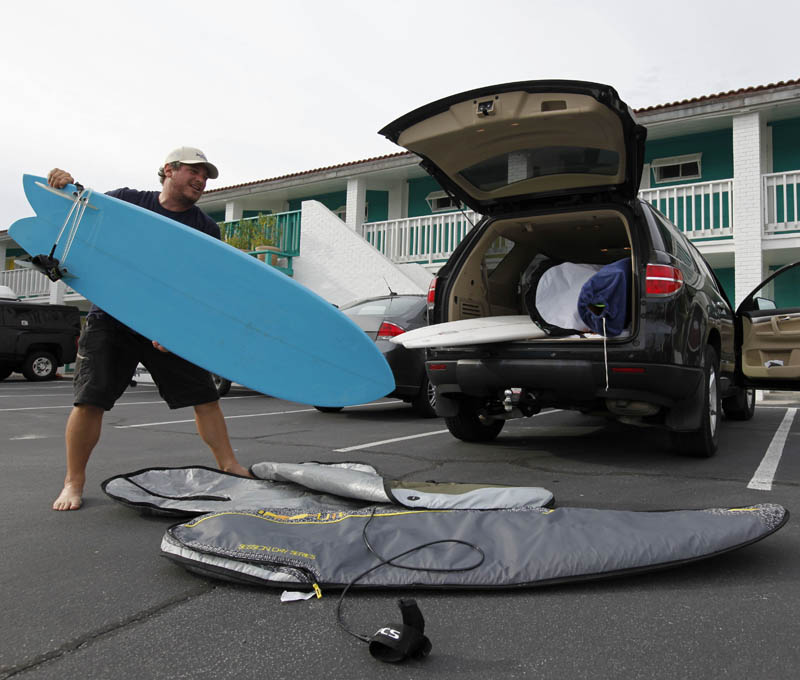 Scott Reese, of Asheville, N.C., packs his surfboards up as he prepares to evacuate for Hurricane Earl, as it heads toward the eastern coast, in Atlantic Beach, N.C., Thursday, Sept. 2, 2010. (AP Photo/Chuck Burton)