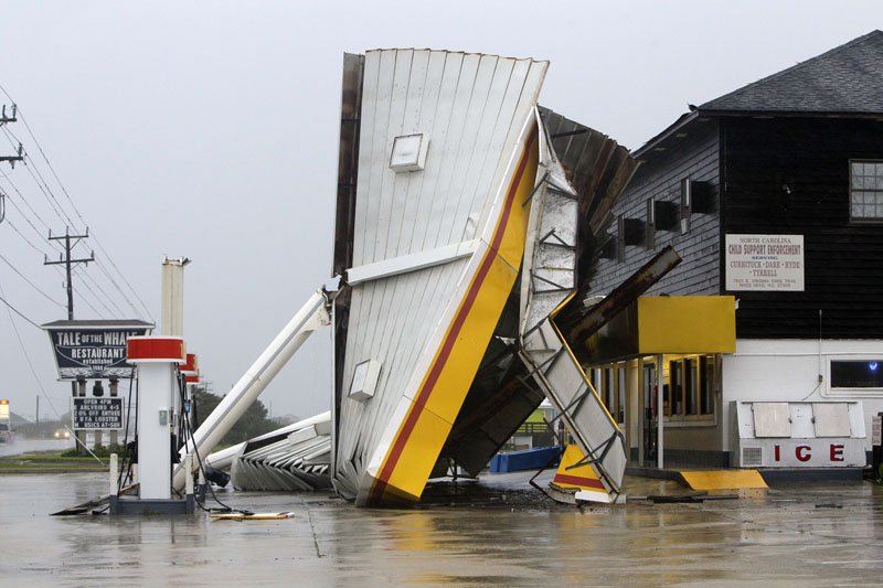 A metal roof is seen on the ground after winds from Hurricane Earl passed through Nags Head, N.C..